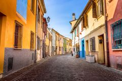 Narrow street of the village of fishermen San Guiliano with colorful houses and bicycles in early morning in Rimini, Italy.  royalty free stock photos