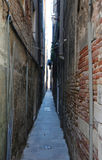 Narrow street with the walls of homes almost touching Stock Photo