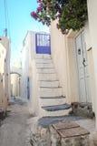 Narrow street and white houses in Emporio village Stock Photos