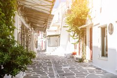 Narrow street with white houses, Greece. Beautiful narrow street with white houses in Mikonas island, Greece. Traditional narrow street with white facedes of Royalty Free Stock Photography