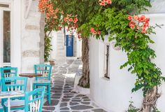 Narrow street with white houses, Greece. Beautiful narrow street with white houses in Mikonas island, Greece. Traditional narrow street with white facedes of Royalty Free Stock Photos