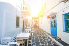 Narrow street with white houses, Greece. Beautiful narrow street with white houses in Naoussa, Paros island, Greece. Traditional narrow street with white facedes Stock Photography