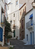 Narrow street with white houses in historical center of Cadaques Spain Stock Photography