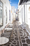 Narrow street with white houses on Paros island, Greece Royalty Free Stock Photos