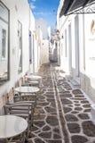 Narrow street with white houses on Paros island, Greece royalty free stock photos