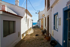Narrow street with white houses Royalty Free Stock Image
