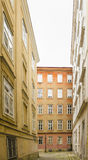 Narrow street with white sky Stock Photos
