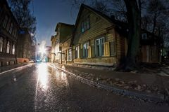 Narrow Street By Winter Night. The rain pours on the streets of Tallinn, Estonia, It`s winter, but the ice and snow are melting in the rain Royalty Free Stock Photography