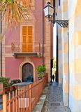 Narrow street with woman silhouette and colorful old buildings in old small coastal town Sestri Levante in Liguria, Italy. Narrow street with woman silhouette stock photo