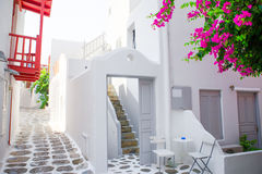 The narrow streets with blue balconies, stairs, white houses and flowers in beautiful village in Greece. Beautiful Stock Photos