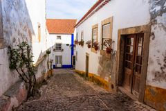 Narrow streets and charming houses of old town Obidos. Portugal stock photos