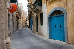 Narrow streets and colorful balconies. Malta. MOSTA, MALTA - AUGUST 21, 2017: The narrow streets with their colorful balconies of Mosta are one of the major Royalty Free Stock Photography