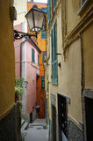 The narrow streets with colorful houses in Riomaggiore on April 14, 2017 Royalty Free Stock Photo