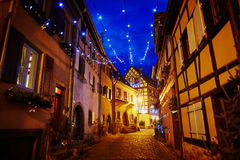 Narrow streets of Eguisheim, Alsace, France decorated for Christmas. Narrow streets of Eguisheim, Alsace, France beautifully decorated for Christmas Stock Images