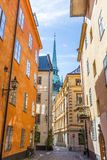 Narrow Streets of Gamla Stan Stockholm. A Picture of the Streets of Gamla Stan Stockholm With colourful Buiildings and a Church in the Background Stock Photography