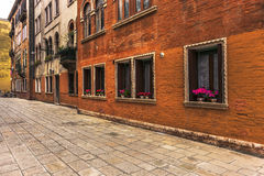 Narrow streets and historic buildings in Venice, Italy Stock Images