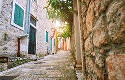 Narrow streets of historical old town Herceg Novi, Boka Kotor gilf. Popular touristic route to Kanli Kula fortress, Montenegro. Narrow streets of historical old stock image