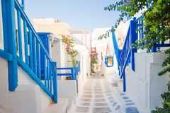 The narrow streets of the island with blue balconies, stairs and flowers. Stock Image