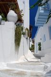 The narrow streets on the island of Mykonos Stock Photo