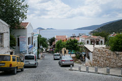 Narrow streets of Kalkan town in Turkey. KALKAN, TURKEY - MAY 22 Narrow streets of Kalkan Town in Mediterranean Turkey descending to sea with stone houses and Stock Photo
