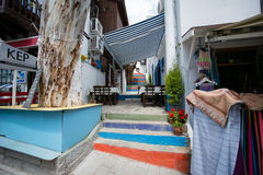 Narrow streets of Kalkan town in Turkey. KALKAN, TURKEY - MAY 22 Narrow streets of Kalkan town in Mediterranean Turkey with multicoloured stairway outside cafe Stock Image