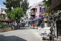 Narrow streets of Kalkan town in Turkey. KALKAN, TURKEY - MAY 22 narrow streets of Kalkan town in Mediterranean Turkey with stone houses cobblestone paved road Stock Photo