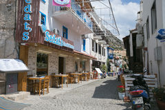 Narrow streets of Kalkan town in Turkey. KALKAN, TURKEY - MAY 22 Narrow streets of Kalkan town in Mediterranean Turkey with stone houses cobblestone paved road Royalty Free Stock Images