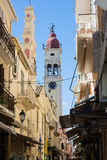 Narrow streets of Kerkyra, Corfu island, Greece. Bell tower of the Saint Spyridon Church. Stock Images