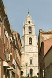 Narrow streets leading to church and bell tower of Mafra, Portugal Stock Photography
