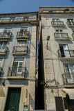 Narrow streets of Lisbon, Portugal with traditional azulejo tiles on building facade.  stock photography