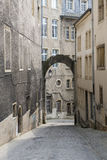 Narrow streets of Luxembourg. Narrow street in Luxembourg with low windows and an arcade Royalty Free Stock Images