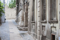 Narrow streets of Old City Baku. Narrow streest of Old City Baku with grape leaves and old stone buildings Royalty Free Stock Photography