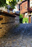 Narrow streets of old town Nessebar, Bulgaria, Black sea coast. Old town Nesebar in Bulgaria: narrow streets and Bulgarian style houses , typical of the Royalty Free Stock Photos