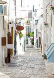 Narrow streets of Ostuni town with white buildings, Puglia, Ital royalty free stock photo