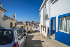 Narrow streets and painted white houses in burgau Royalty Free Stock Photo