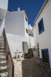 Narrow streets and painted white houses in burgau Stock Photo