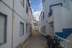 Narrow streets and painted white houses in burgau Stock Images