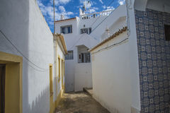 Narrow streets and painted white houses in burgau Royalty Free Stock Photos