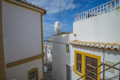 Narrow streets and painted white houses in burgau Stock Photos