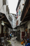 Narrow streets of Stone Town - main city of Zanzibar, old colonial province Royalty Free Stock Photo