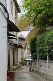 Narrow streets of Stone Town - main city of Zanzibar, old colonial province Stock Photo