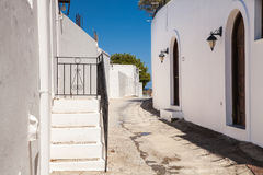 Narrow streets and typical Greek buildings in the city of Lindo.s Royalty Free Stock Images