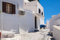 Narrow streets and typical Greek buildings in the city of Lindos Royalty Free Stock Images