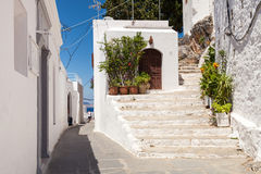 Narrow streets and typical Greek buildings in the city of Lindos Stock Image
