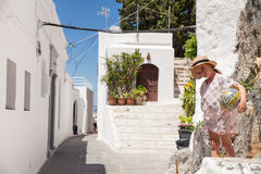 Narrow streets and typical Greek buildings in the city of Lindos Royalty Free Stock Image