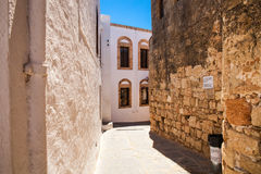 Narrow streets and typical Greek buildings in the city of Lindos. Royalty Free Stock Images