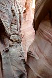 Narrow striped slot canyon walls. Stock Image