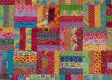 Narrow Strips of Fabric in Squares. On Homemade Quilt stock images