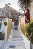 Narrow tourist street with white steps in the Cycladic style in the Athens district of Anafiotika. Narrow tourist street with white steps in the Cycladic style royalty free stock photo