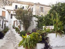 Narrow tourist street with white steps in the Cycladic style in the Athens district of Anafiotika. Narrow tourist street with white steps in the Cycladic style royalty free stock image